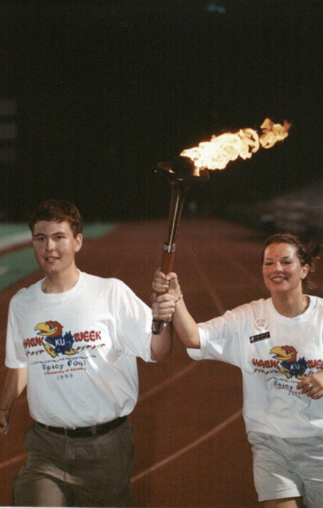 Photograph of students carrying a torch at Traditions Night 1999