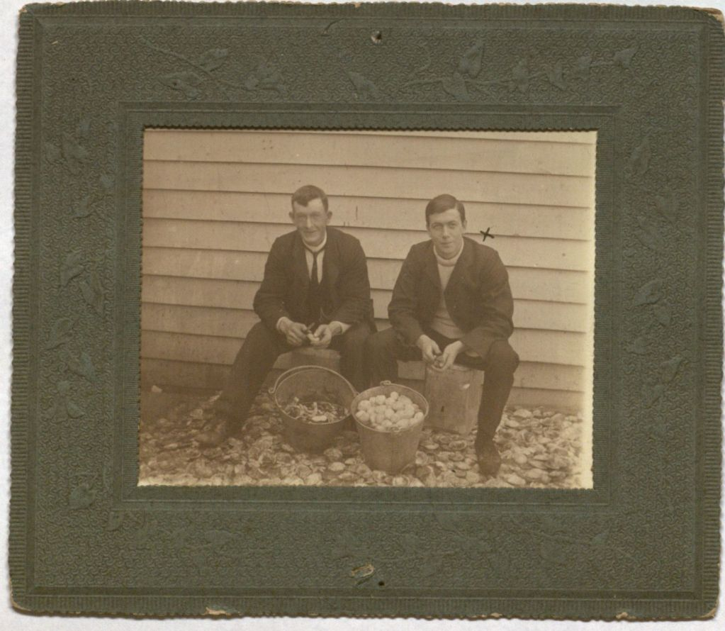 Photograph of Hector C. Henderson (right) and unidentified man.