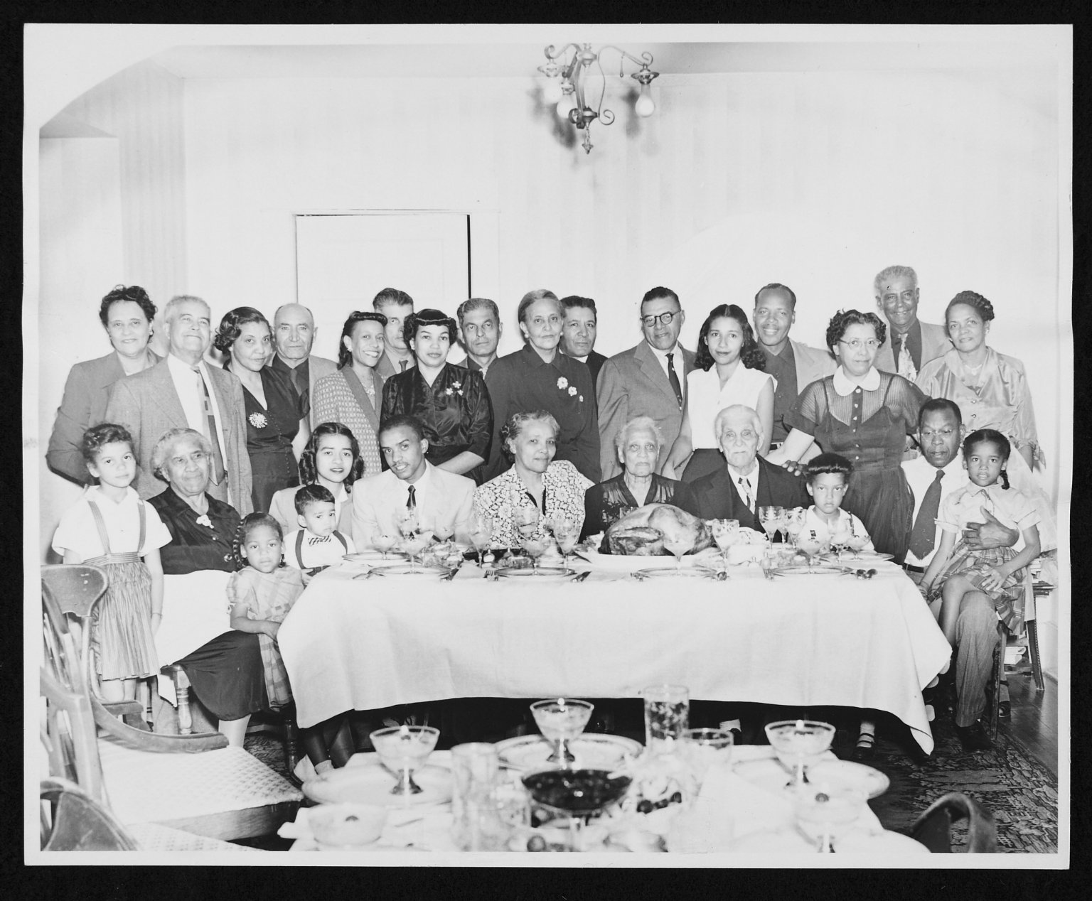 Photograph of Graves-Williams-Dandridge family at Thanksgiving.  Wichita, Kansas. 1953.