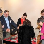 "Photograph of guests examining an exhibition case at the exhibition opening of ""100 Years of Jayhawks, 1912-2012"""
