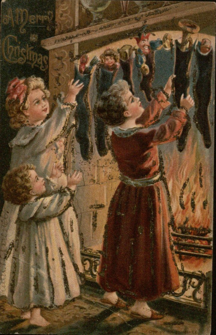 Christmas Postcard featuring children hanging stockings by the fire, ca. 1900-1910