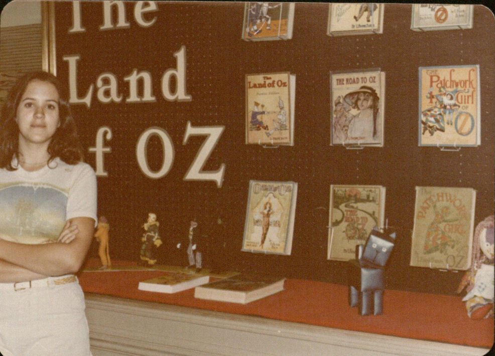 Image of Jane Albright in front of Oz exhibit at KSRL, 1977
