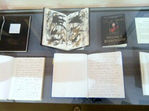 Image of display case containing five of William S. Burroughs' last journals, as seen from above.