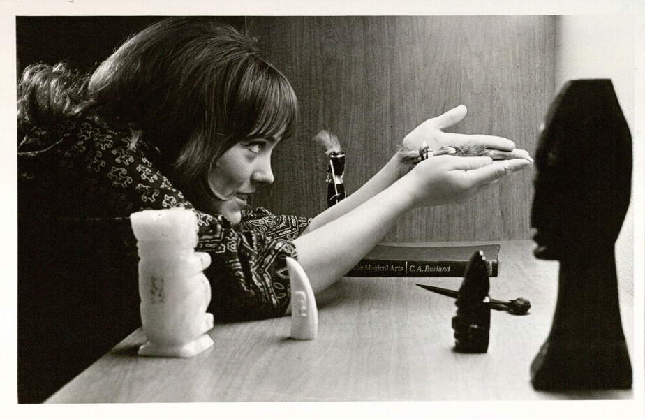 Photograph of a female KU student with an offering, 1970