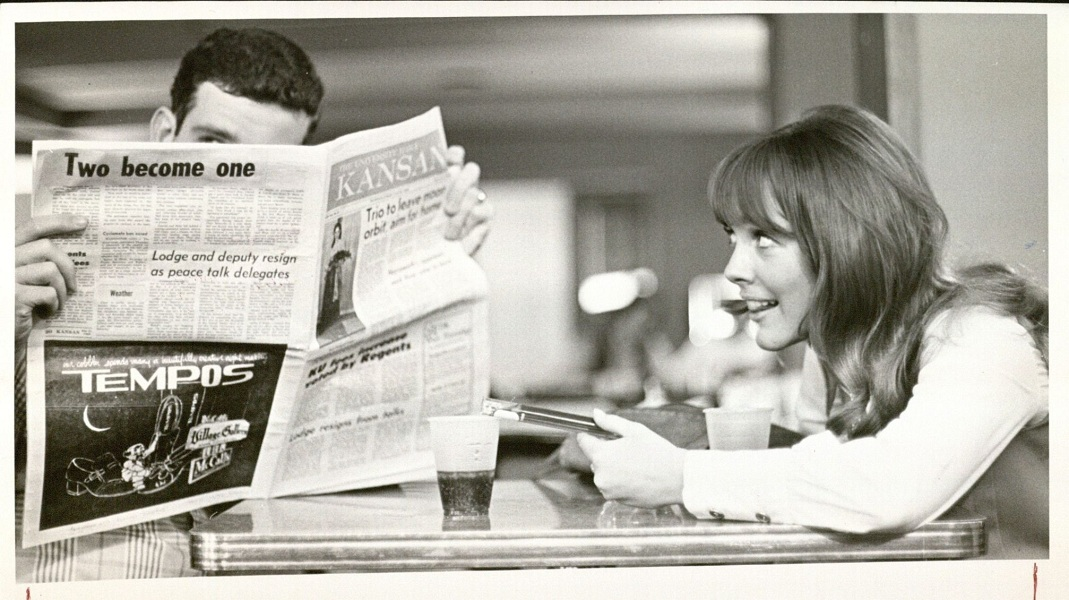 Photograph of a female KU student using love potion, 1970