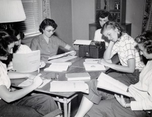 Photograph of group of female students studying, 1950s.