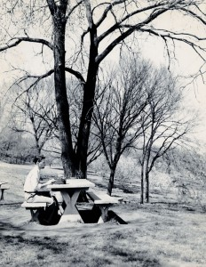 Photograph of student with typewriter outside, 1950s.