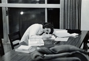 Photograph of student asleep while studying, 1967-1968.