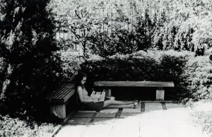 Photograph of student studying under trees, 1969-1970.