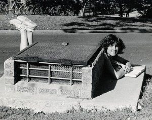 Photograph of student studying behind grate, 1979-1980.