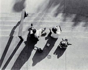Photograph of two students studying on stairs, 1980-1981.