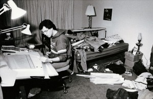 Photograph of student working in his room, 1982-1983.