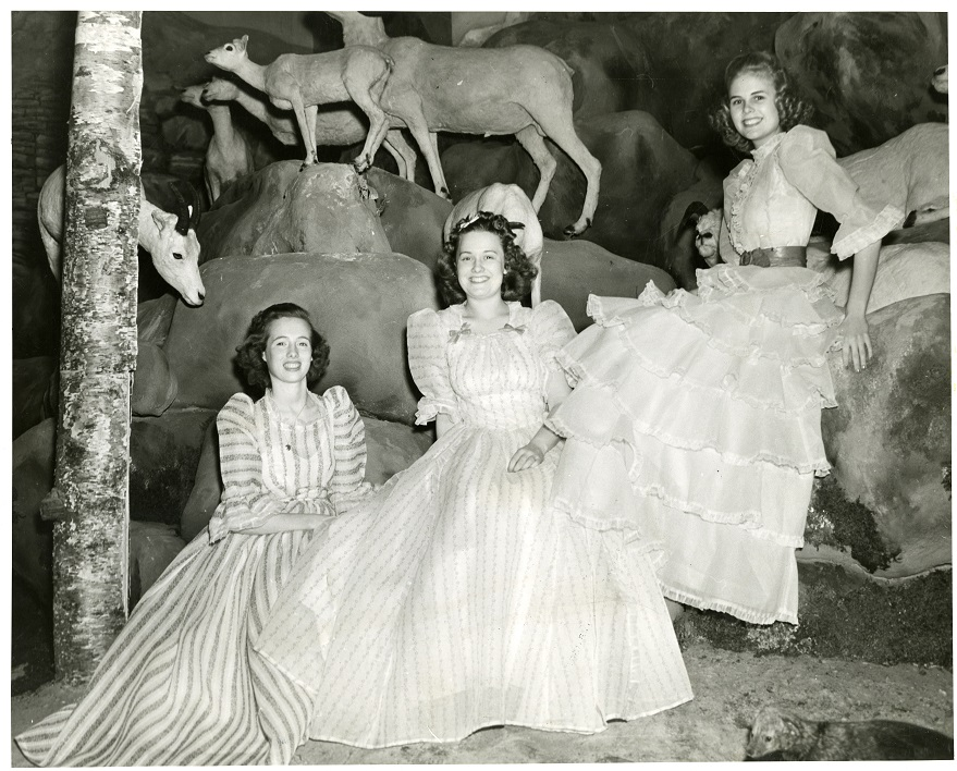 Women posing in a section of the diorama in the newly reopened Dyche Museum, 1941