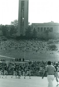 Photograph of the hill and campanile during a football game, 1975-1976