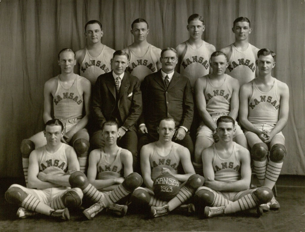 Photograph of KU men's basketball team with Adolph Rupp, Phog Allen, and James Naismith, 1922-1923