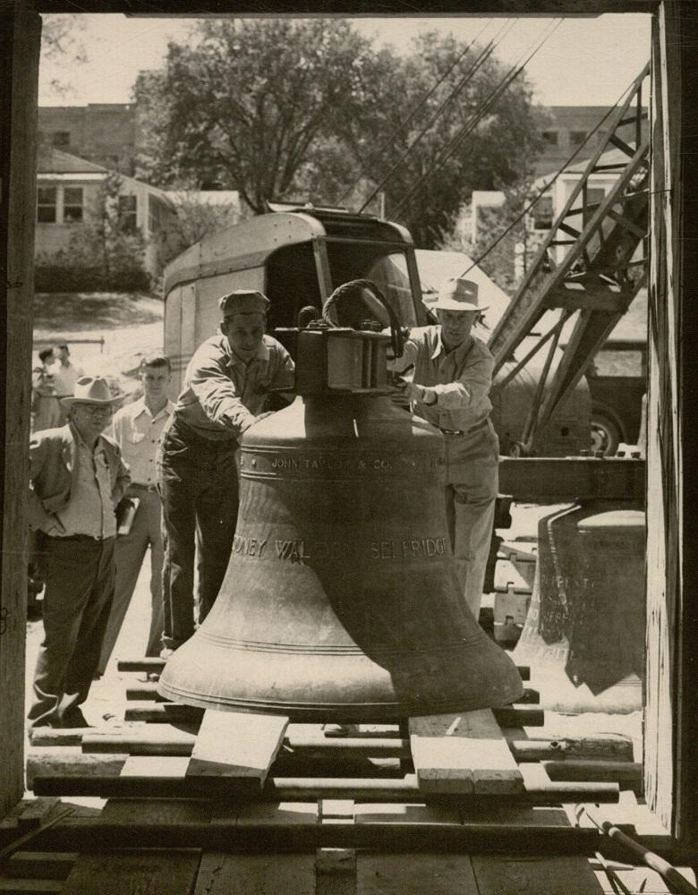 Photograph of men unloading the bells, 1951