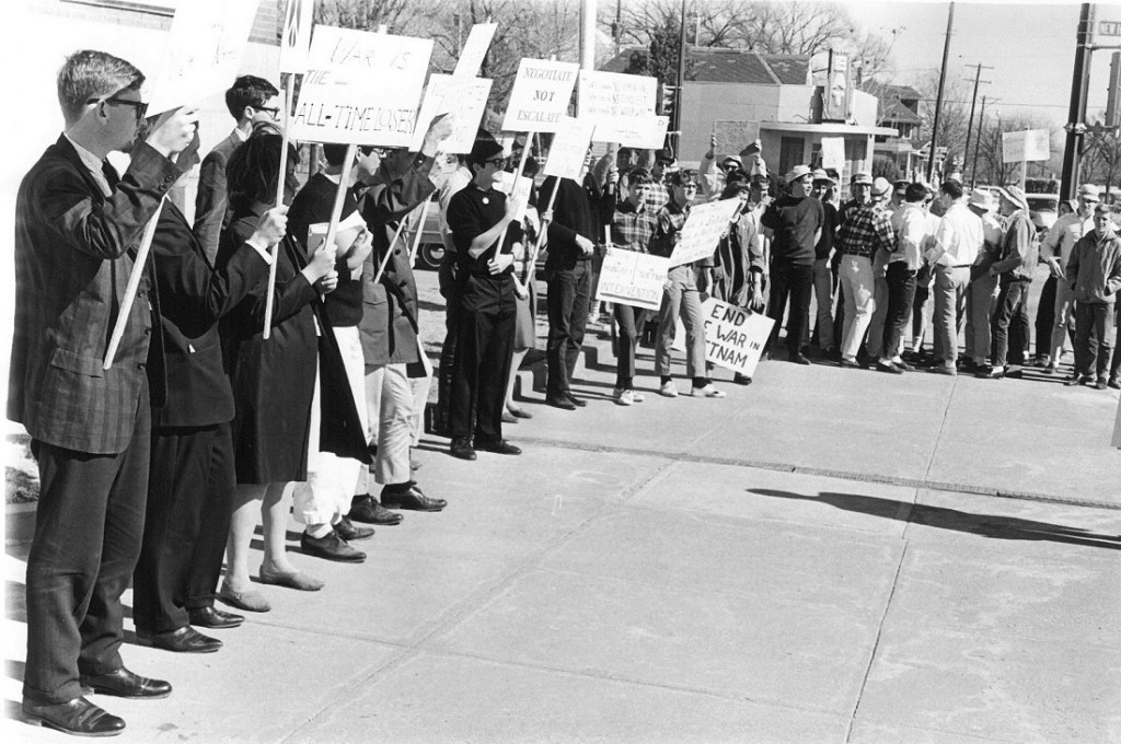 Photograph of a group of Vietnam protestors in downtown Lawrence, 1965 February 21