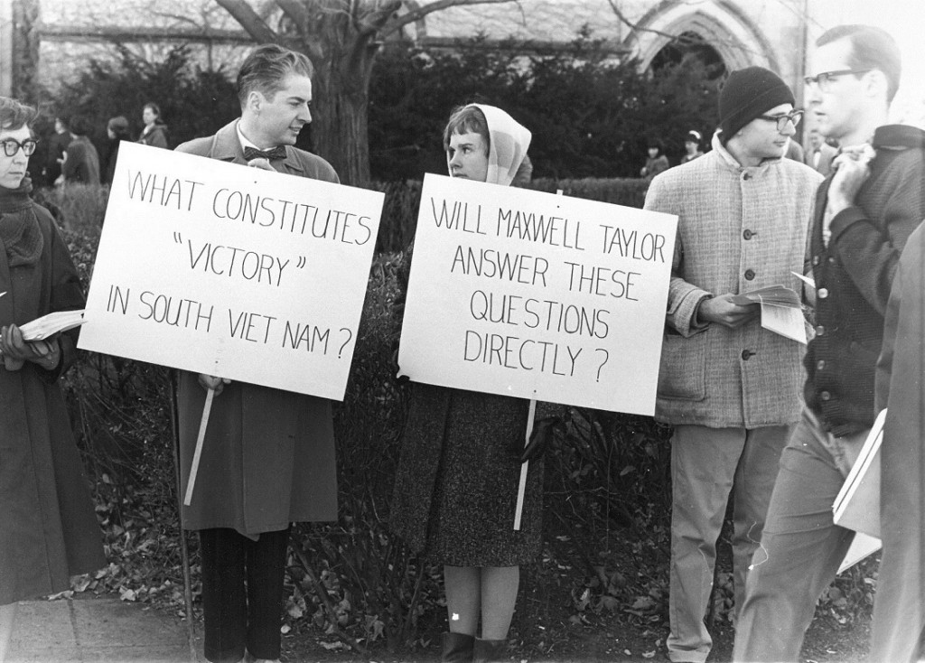 Photograph of protests in advance of Maxwell Taylor's speech, 1965 December 5