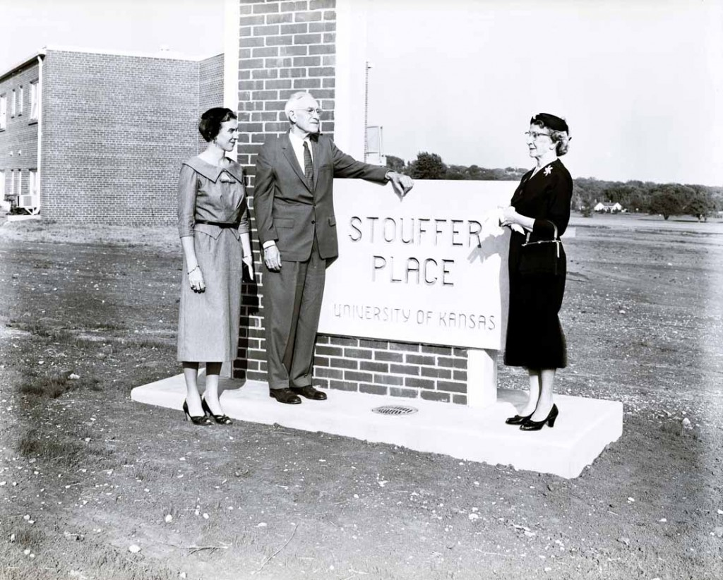Photograph of Ellis B. Stouffer standing next to Stouffer Place sign, 1950s