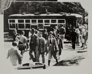 Students exiting streetcar, KU Campus