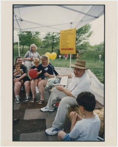 Chancellor Hemenway reading a story at Mayfest, Potter Lake, 1998