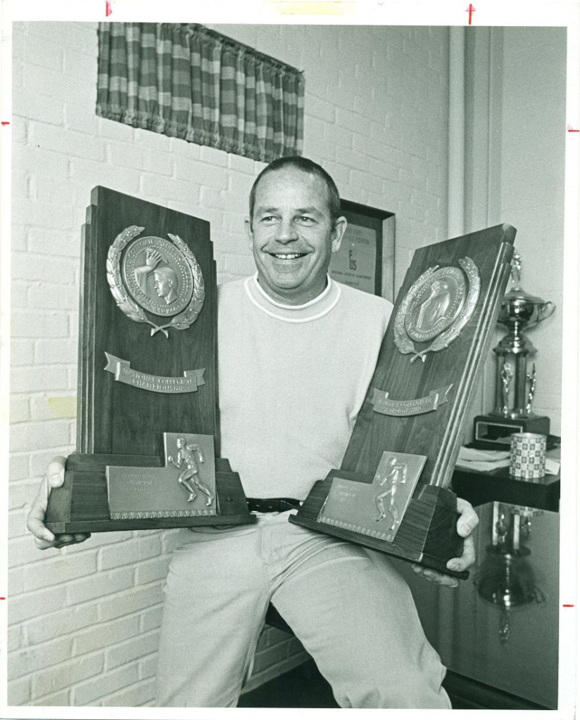 Photograph of Coach Bob Timmons with two National Championship trophies