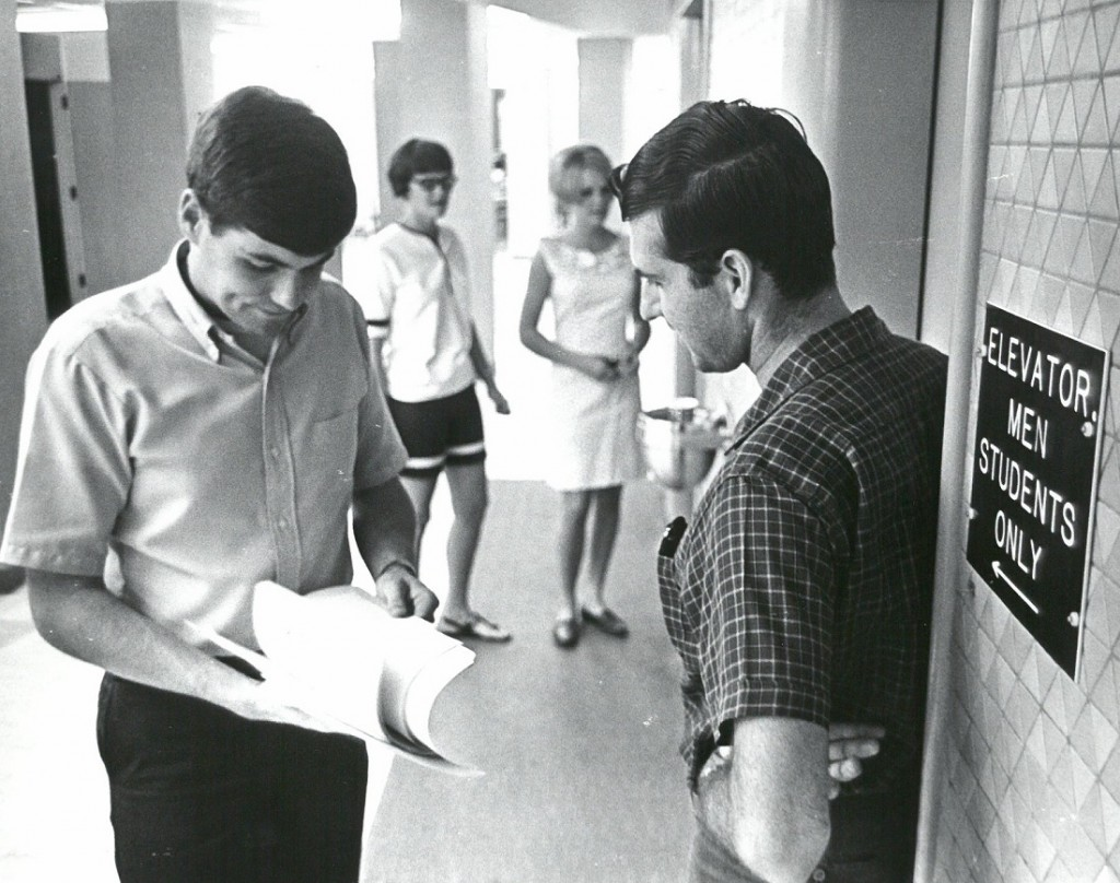 Photograph of four students at the crossroads of McCollum Hall, 1967