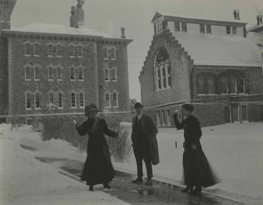 Photograph of people throwing snow, 1910s