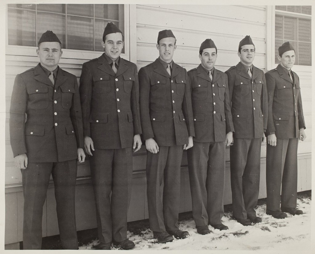 Photograph of members of the KU men's basketball team in Army uniforms, 1942-1943