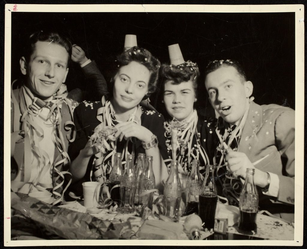 Photograph of a group at a party, 1943-1944