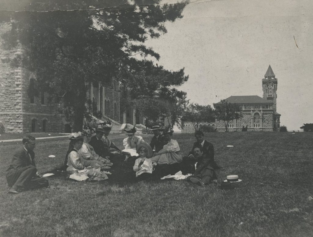 Photograph of students relaxing on campus, 1900-1909