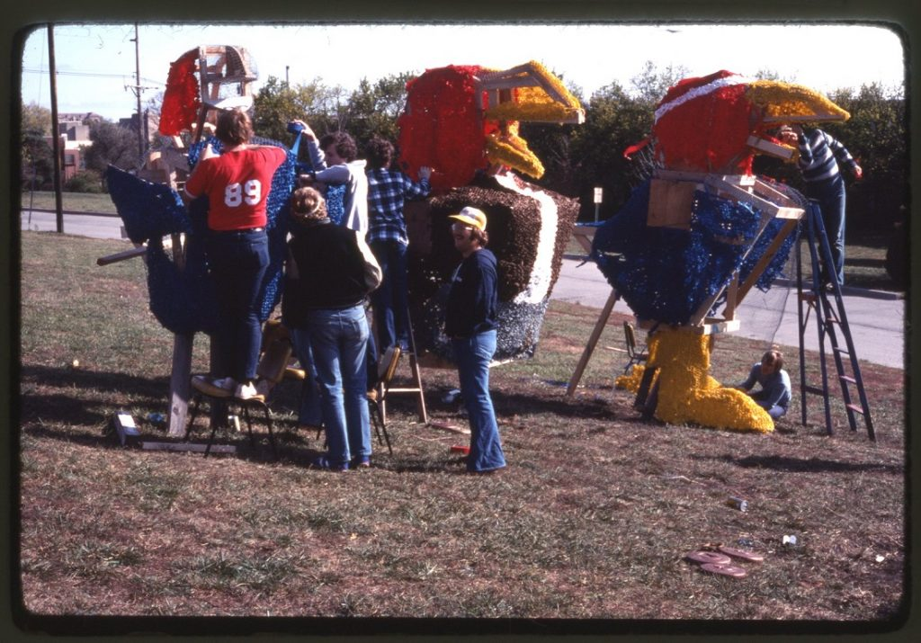Photograph of KU students working on a Homecoming display, 1973