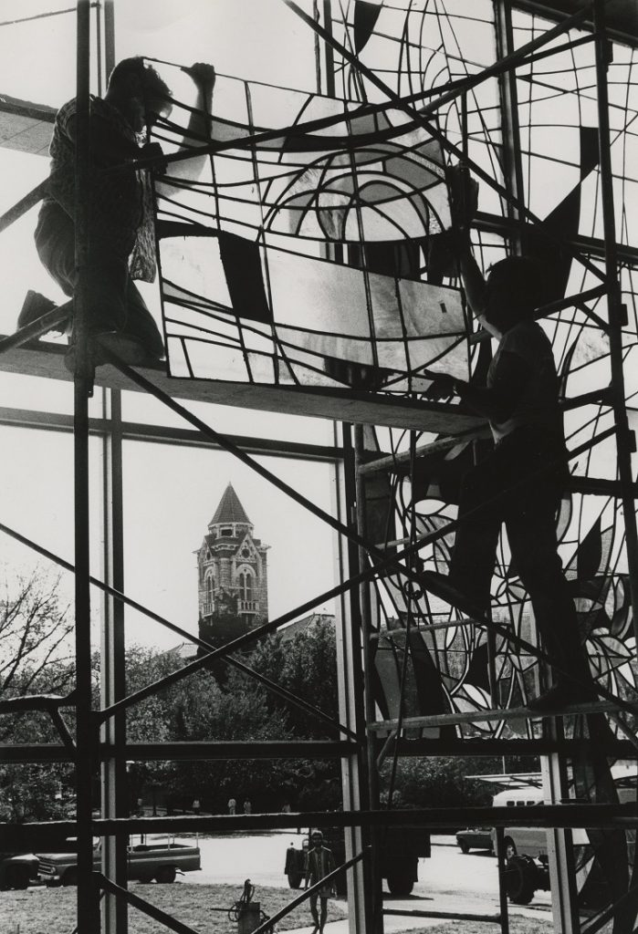 Photograph of workers installing stained glass windows in Smith Hall, 1967