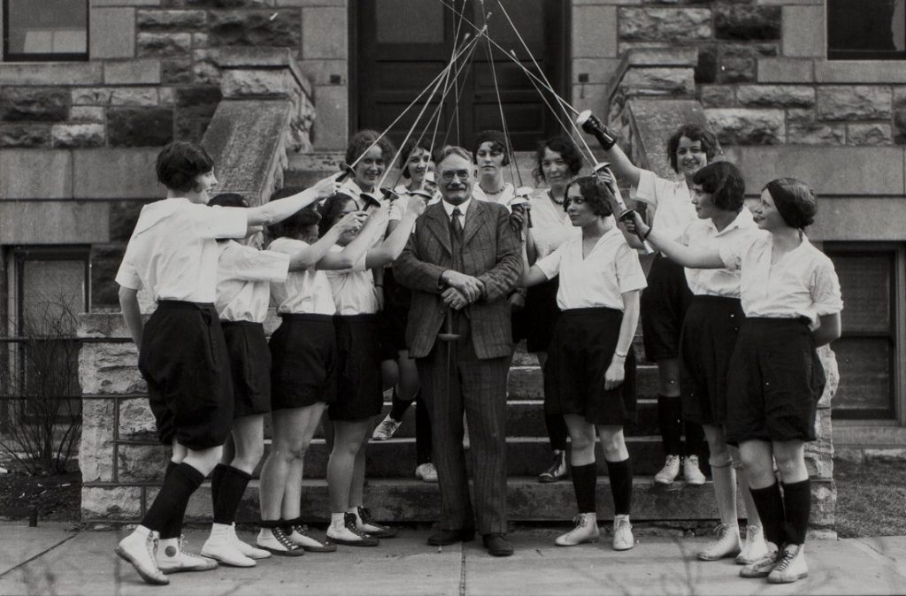 Photograph of a fencing class with James Naismith, 1926