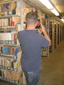 Consultant in stacks, Spencer Research Library, University of Kansas.