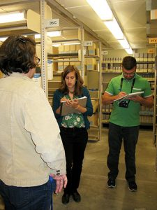Consultants in stacks, Spencer Research Library, University of Kansas.