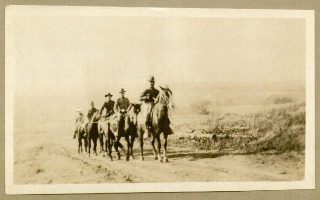 Photograph of men on horses, enclosed with Forrest W. Bassett letter to Ava Marie Shaw, November 11, 1917