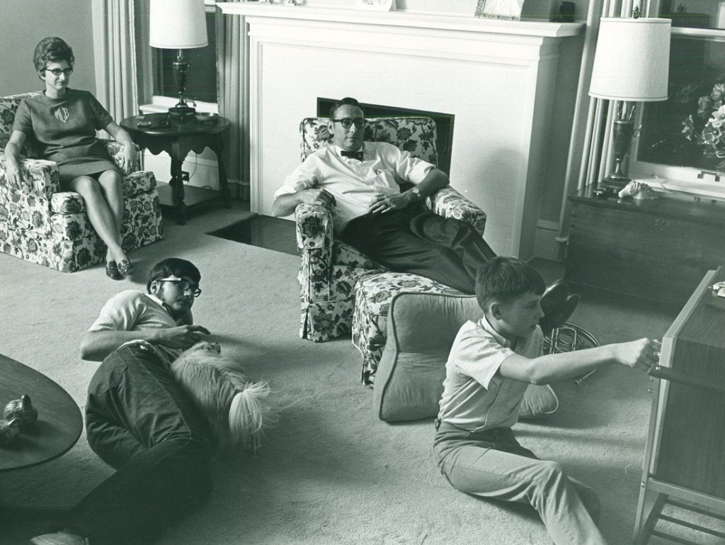 Photograph of Chancellor Laurence Chalmers watching television with his family, 1970