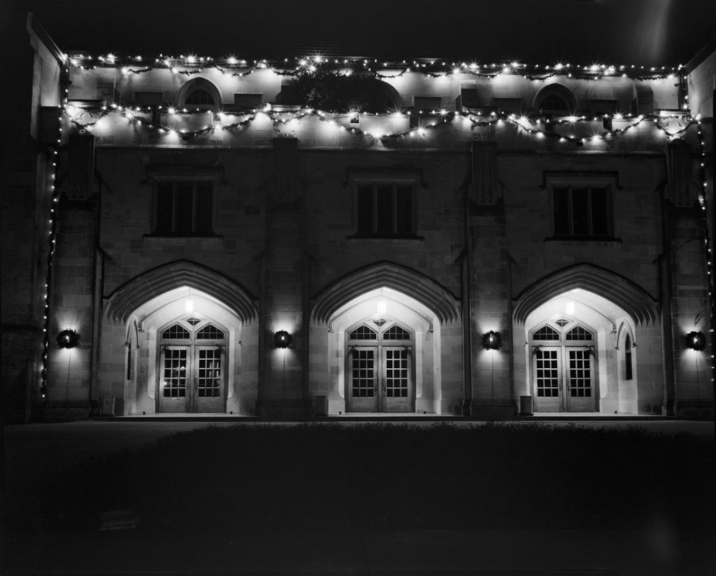 Photograph of Hoch Auditorium with holiday lights, 1954