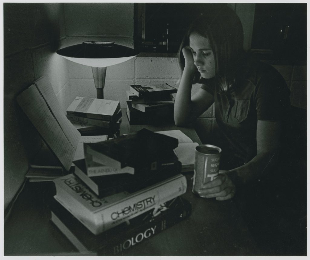 Photograph of a student studying, 1970-1971