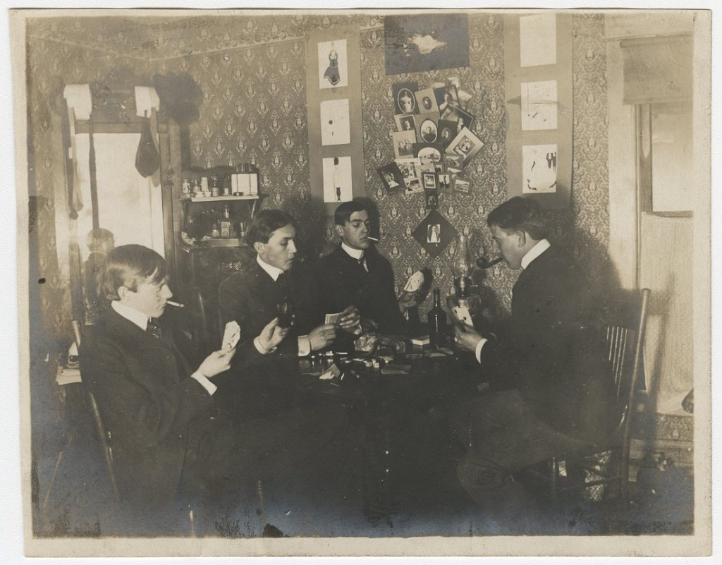 Photograph of KU students playing cards, 1900