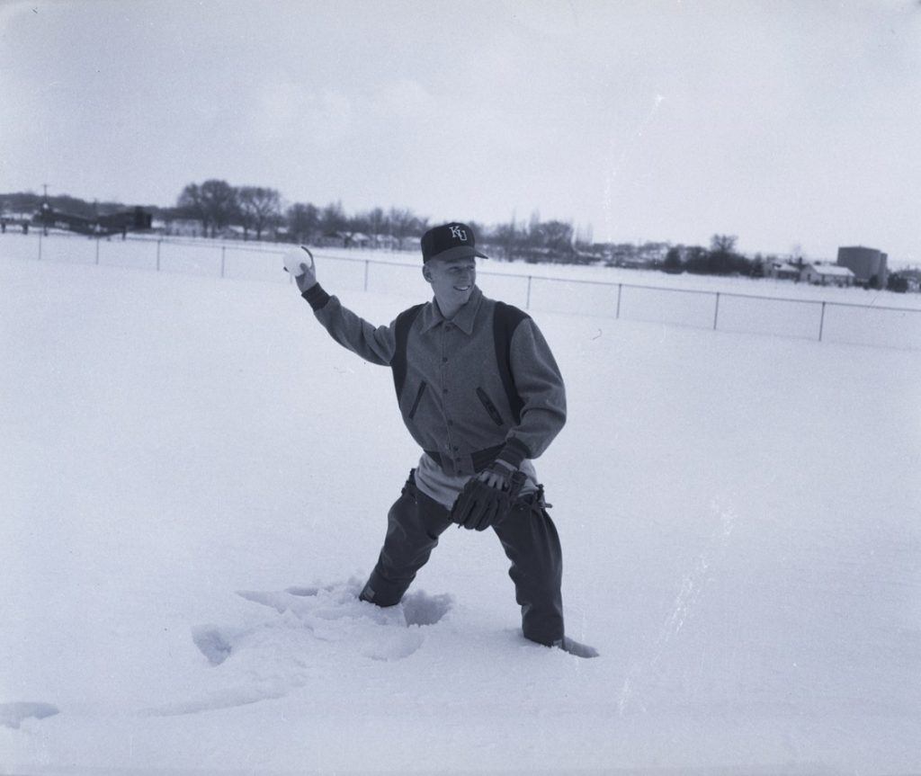 Photograph of a KU baseball player in the snow, 1950s