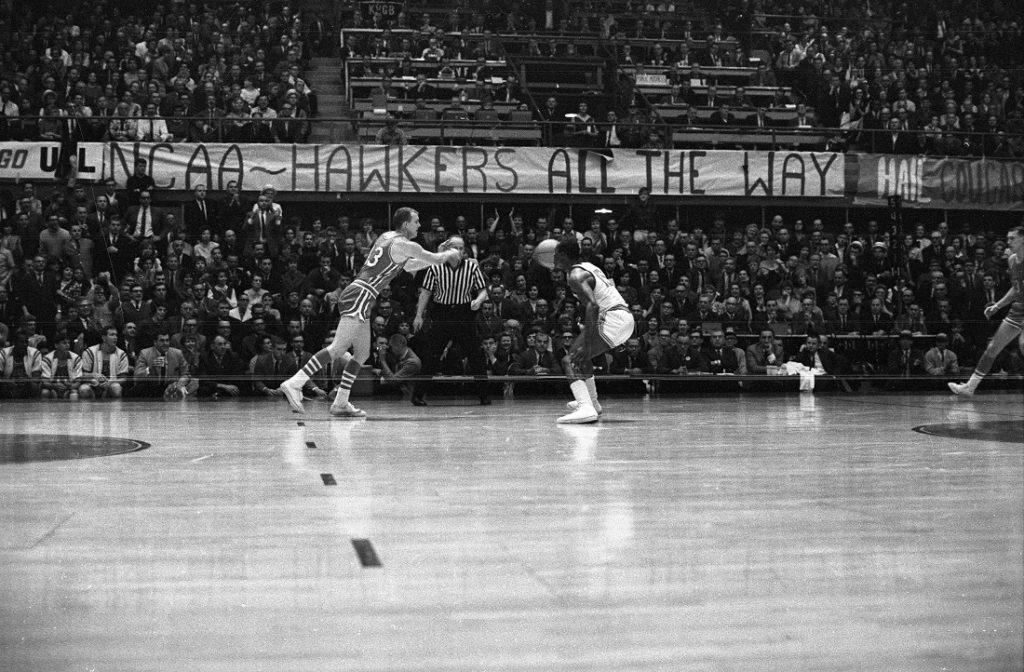 Photograph of a NCAA sign at a KU vs. University of Houston game, 1966-1967