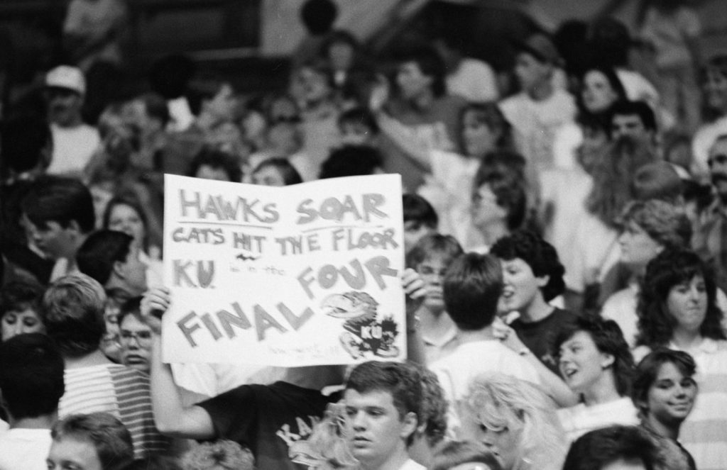 Photograph of KU basketball fans holding a sign, 1988