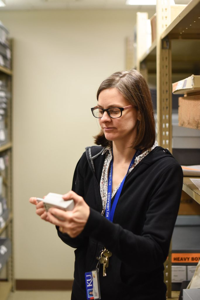 Staff member using a datalogger in the Spencer Library stacks, University of Kansas Libraries