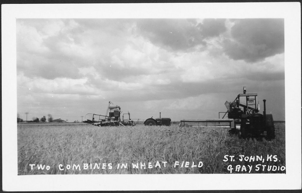 Photograph of two combines in a wheat field, St. John, Kansas, 1945-1949