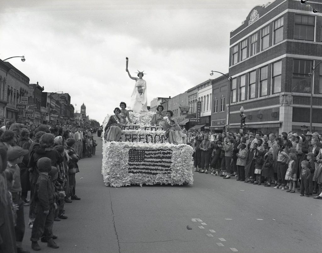 Photograph of a patriotic float in a Kansas Relays parade, 1950s