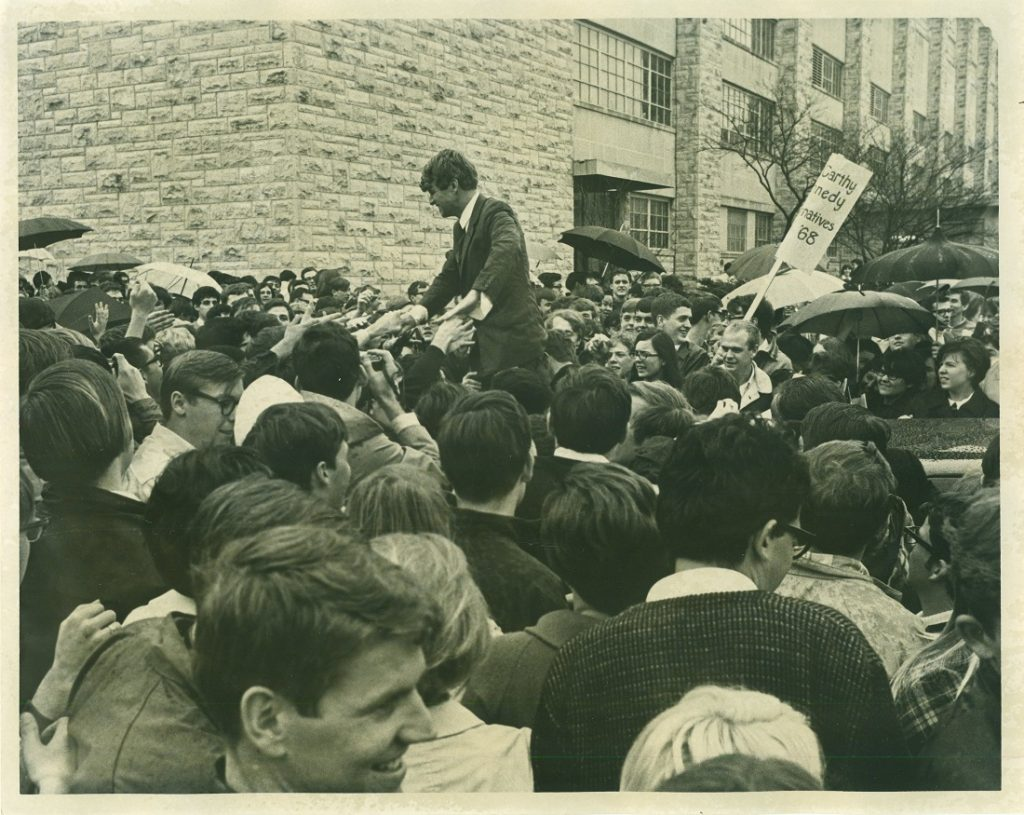 Photograph of Robert F. Kennedy with KU students outside Allen Fieldhouse, March 18, 1968