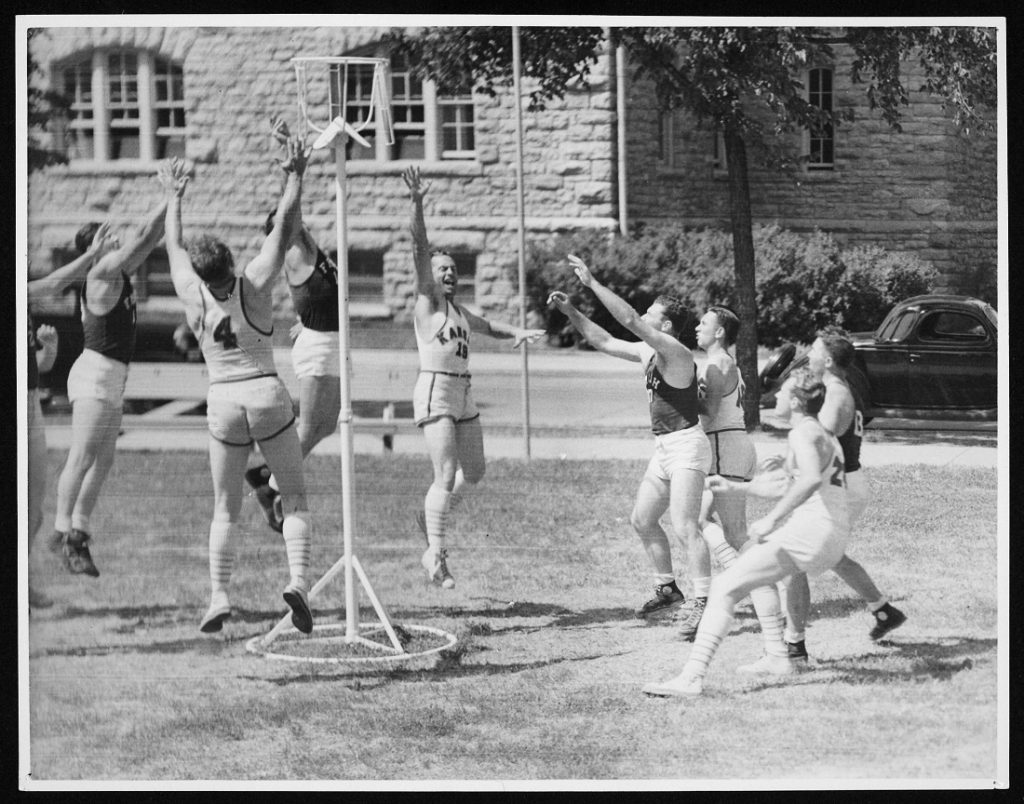 Photograph of the KU basketball team playing goal-hi, 1939