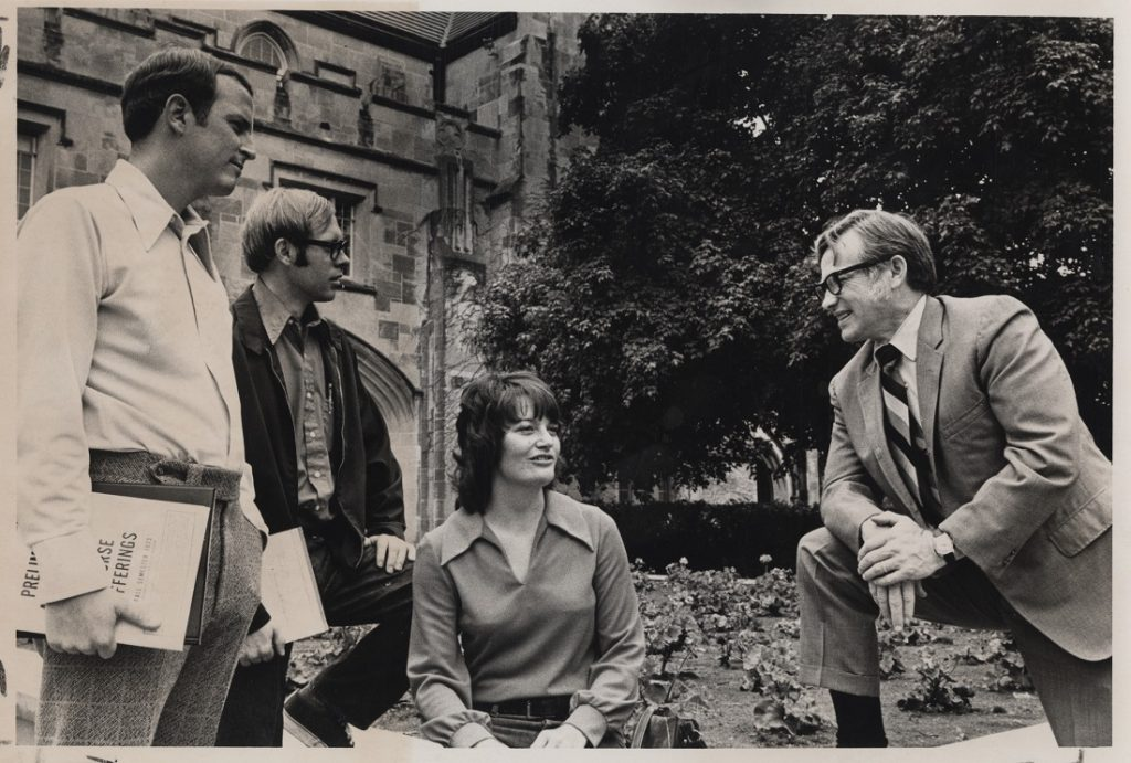 Photograph of Del Shankel with students outside Hoch Auditorium, 1973